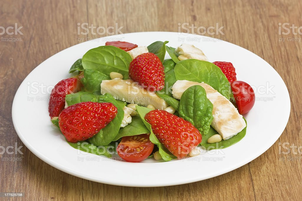 Spinach chicken strawberry salad royalty-free stock photo