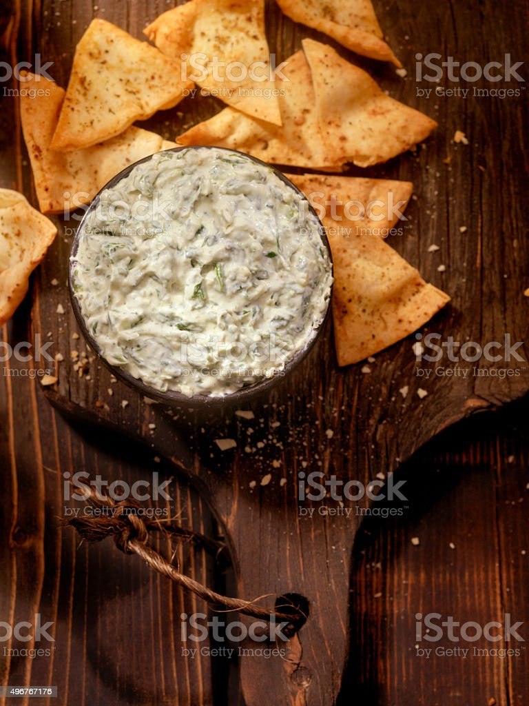 Spinach Dip with Baked Pita Chips stock photo