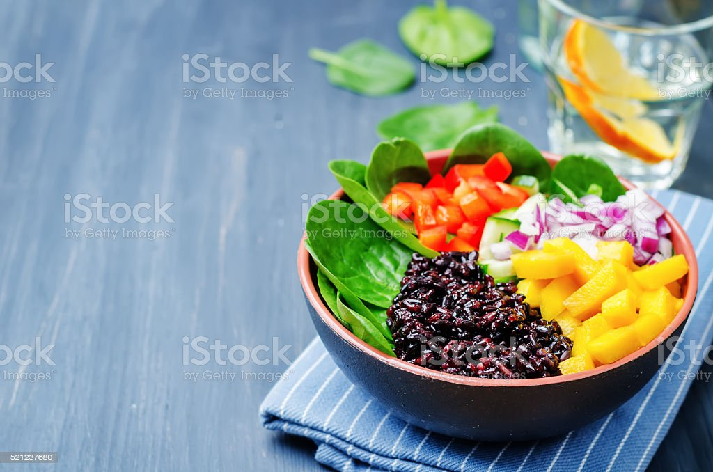 spinach, mango, black rice, pepper salad stock photo