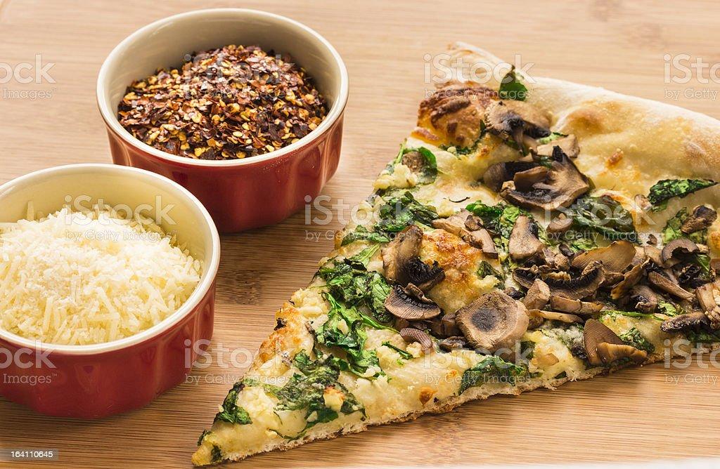 Spinach, Mushroom and Garlic Pizza royalty-free stock photo