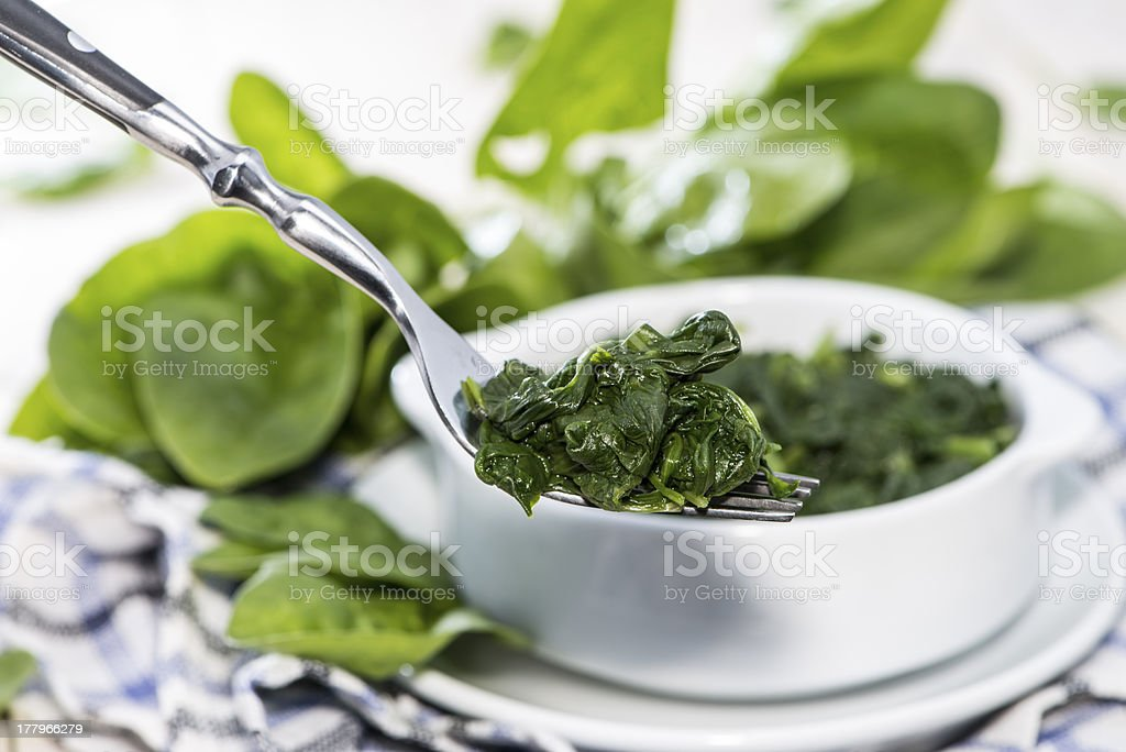 Spinach on a fork stock photo