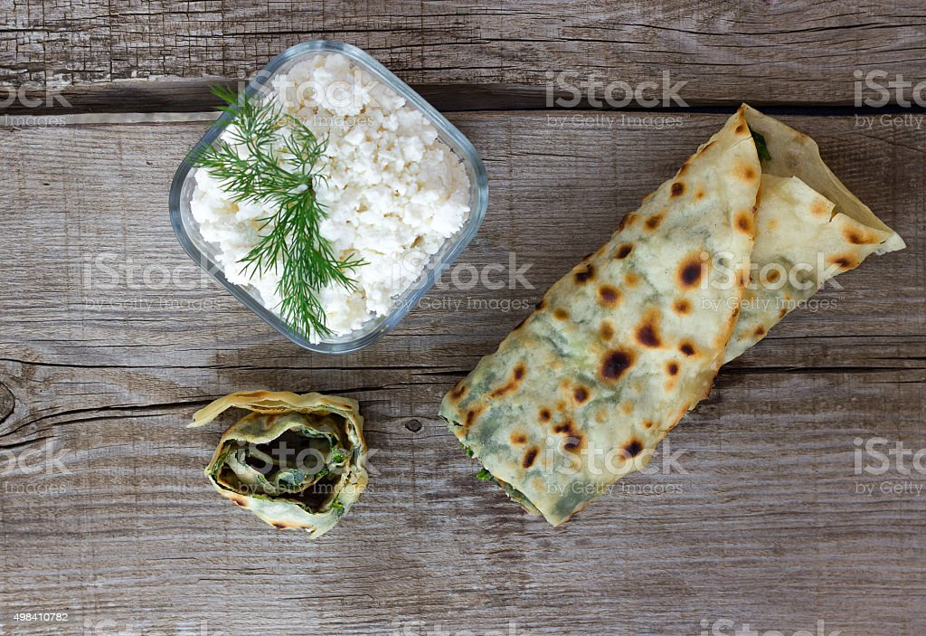 Spinach pie baked on a wood-fired (Turkish Borek) stock photo