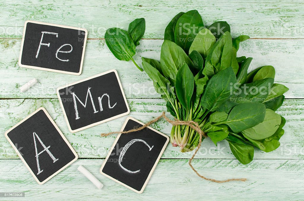 Spinach rich in vitamin C, A, manganese and iron stock photo