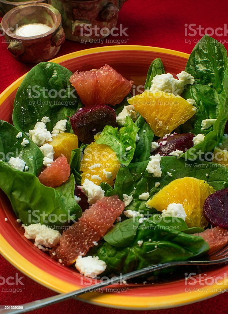 Spinach salad on a red background stock photo