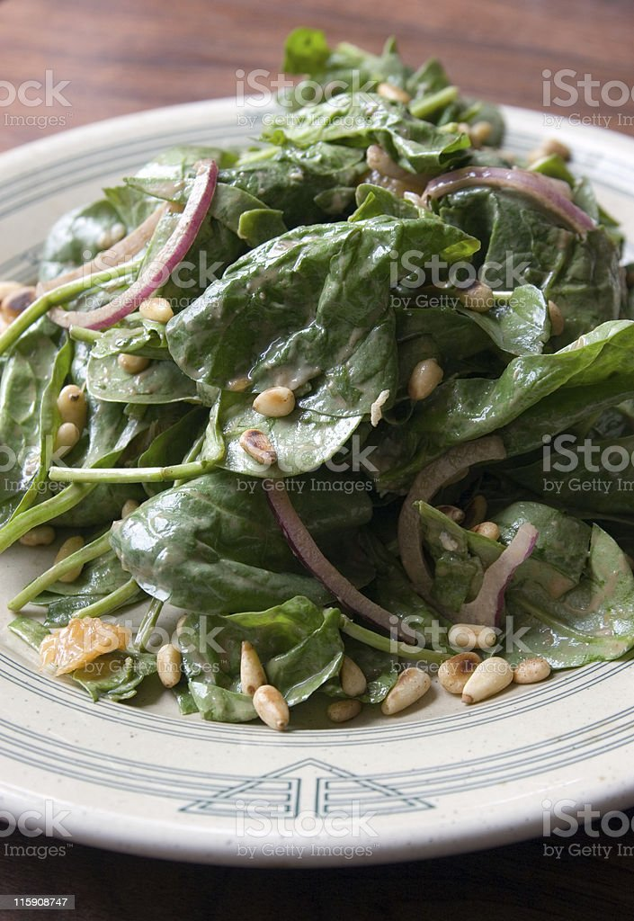 Spinach Salad with Pine Nuts royalty-free stock photo