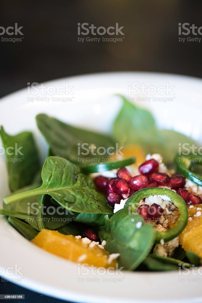 Spinach Salad with Pomegranate, Orange and Goat Cheese stock photo