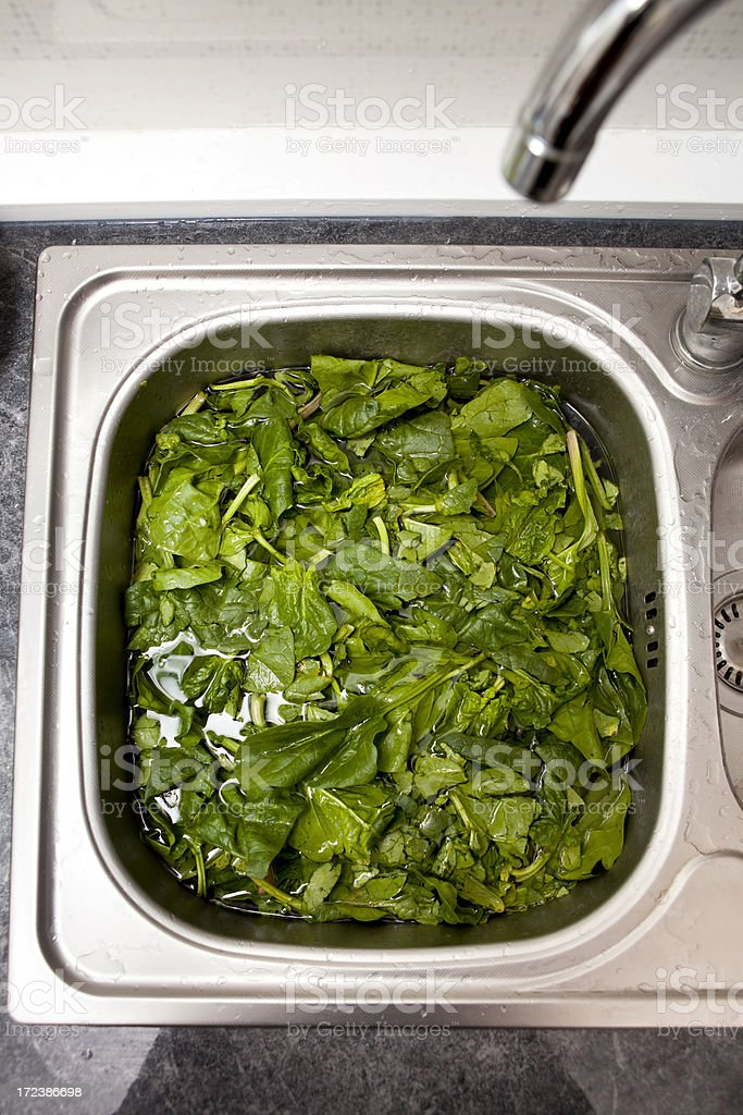 spinach submerged in water royalty-free stock photo