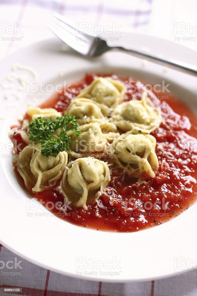 spinach tortellini with tomato sauce royalty-free stock photo