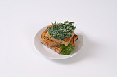 Spinach with cream and toast