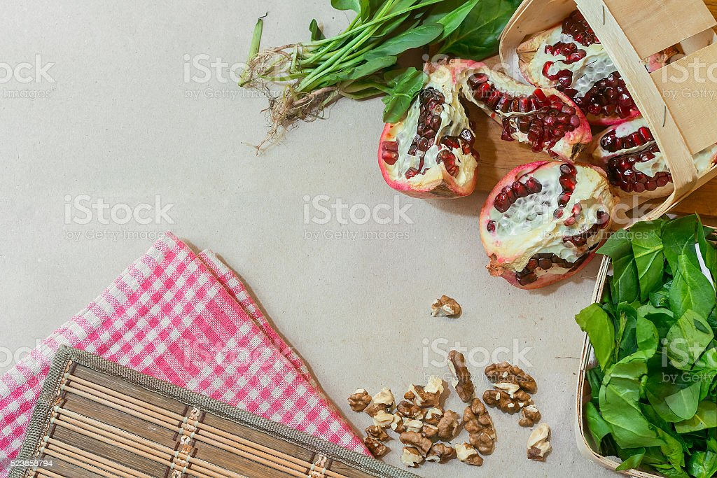 spinach with garnet and nuts stock photo