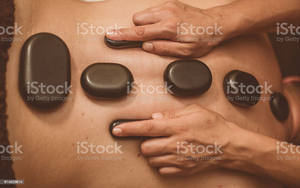 Spinal Hot Stone Therapy Details stock photo