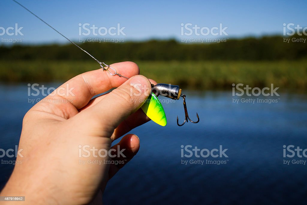 spinner with a triple hook for fishing stock photo