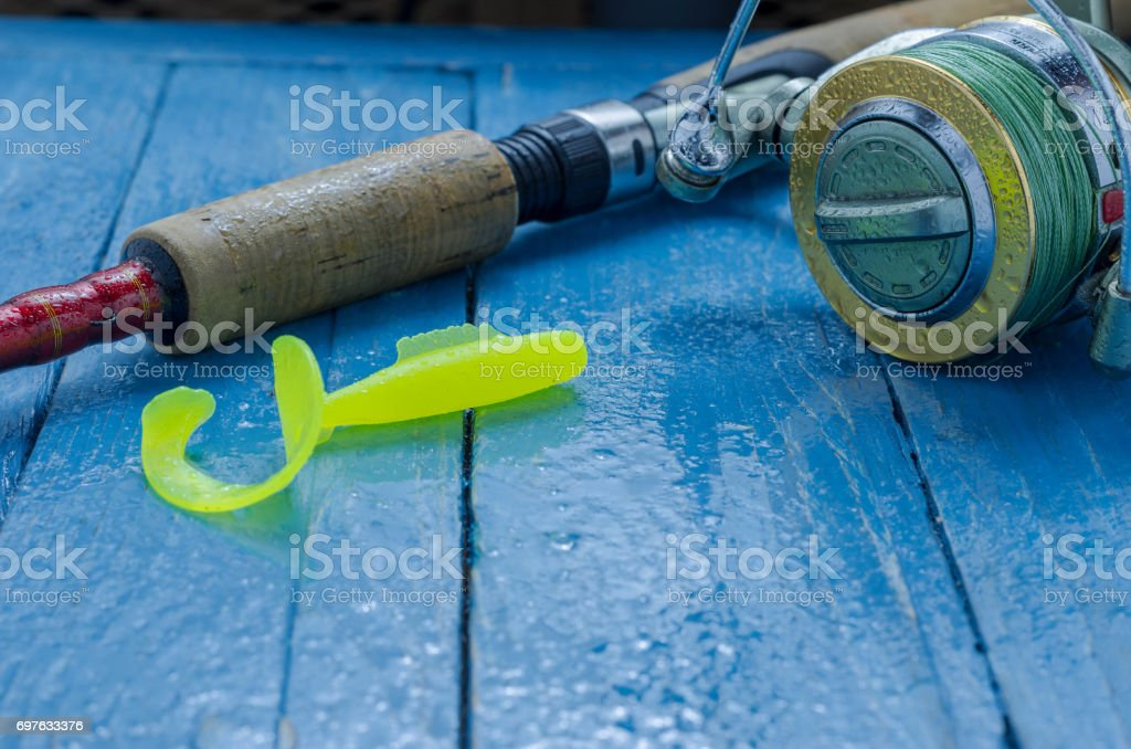Spinning and soft bait for fishing. Water drops. Decorative background. stock photo