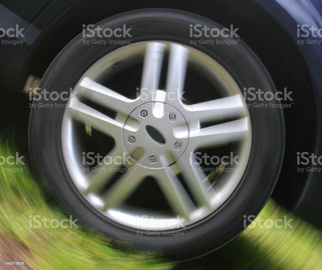spinning car wheel royalty-free stock photo