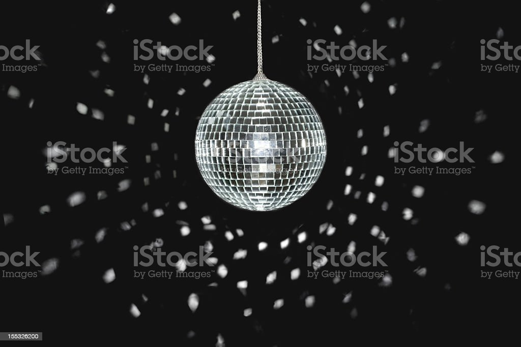 Spinning discoball on black background stock photo