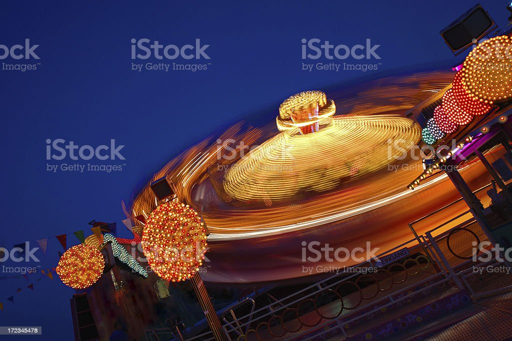Spinning faiway ride on Oktoberfest royalty-free stock photo