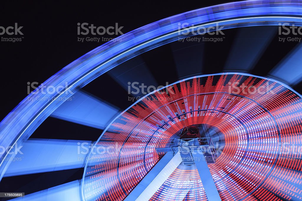 Spinning fun with a ferris wheel stock photo