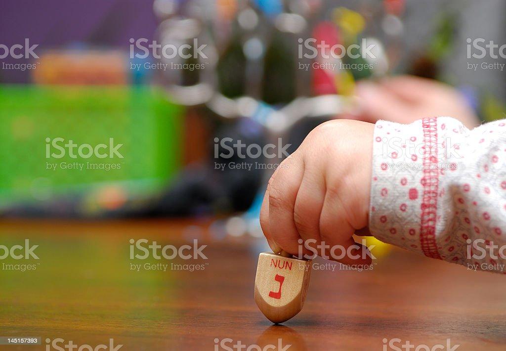 Spinning the dreidel stock photo