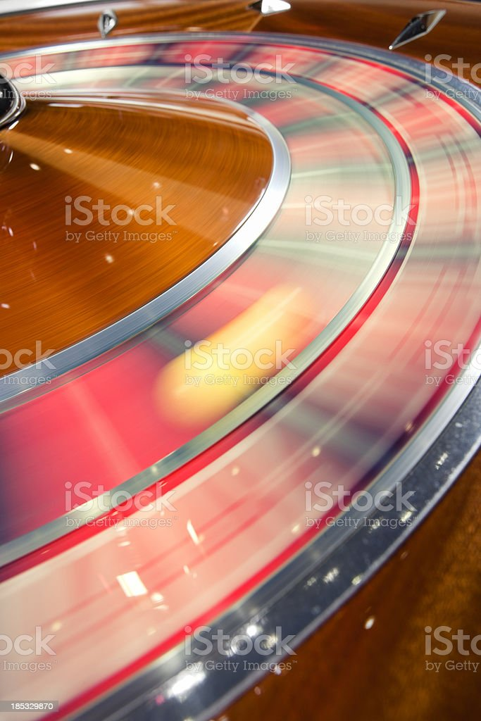 Spinning the Roulette Wheel with ball Gambling stock photo