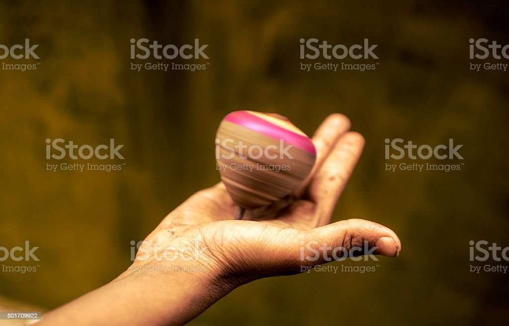 Spinning top on hand. stock photo