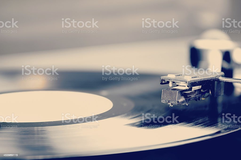 Spinning vinyl record. Motion blur image.  Vintage toned. stock photo