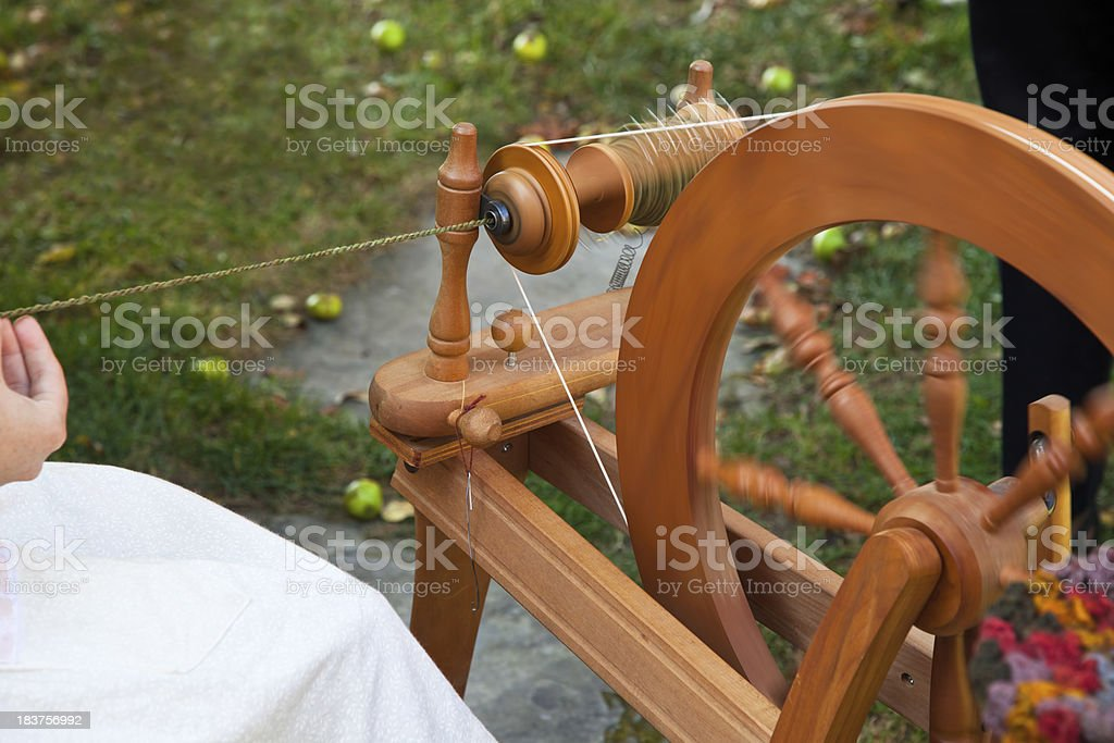 Spinning wheel in motion stock photo