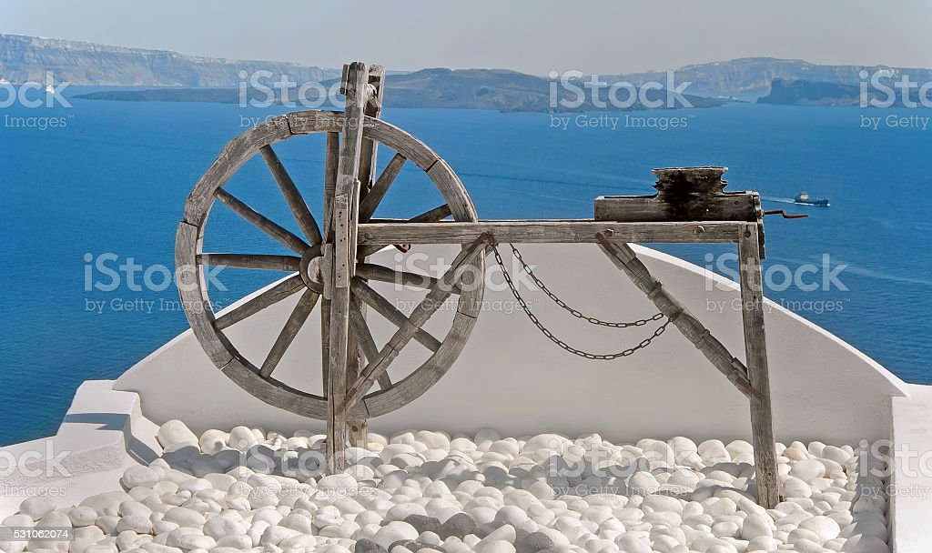 Spinning wheel in Oia, Santorini, Greece stock photo