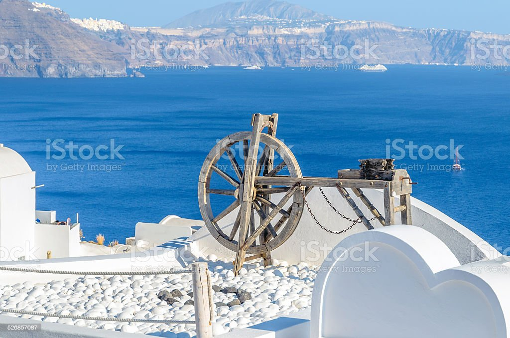 Spinning wheel in the stunningly beautiful town of Oia stock photo