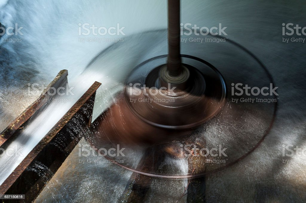 Spinning wheel of a water mill stock photo