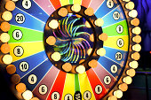 Spinning wheel of fortune with light bulbs and colors