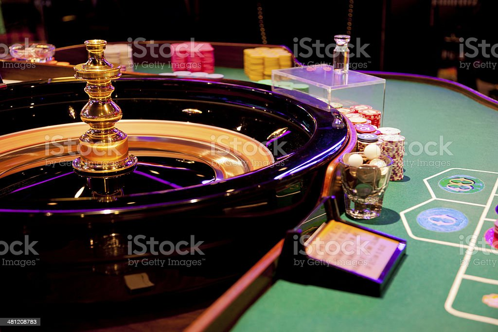 Spinning wheel on the roulette table in a casino stock photo