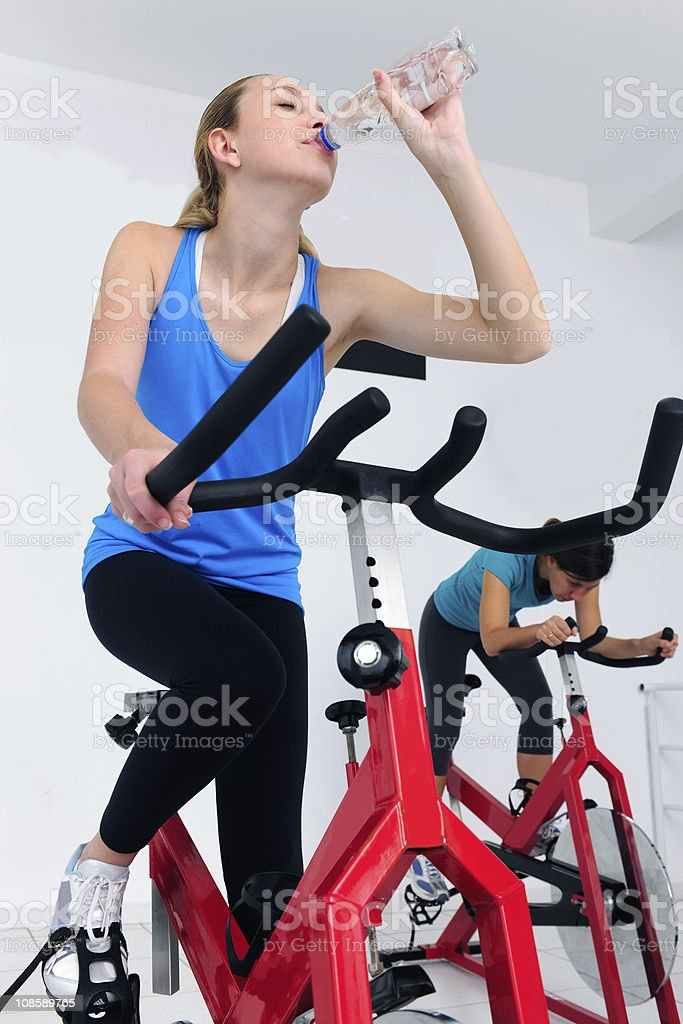 spinning: woman cycling at the gym royalty-free stock photo