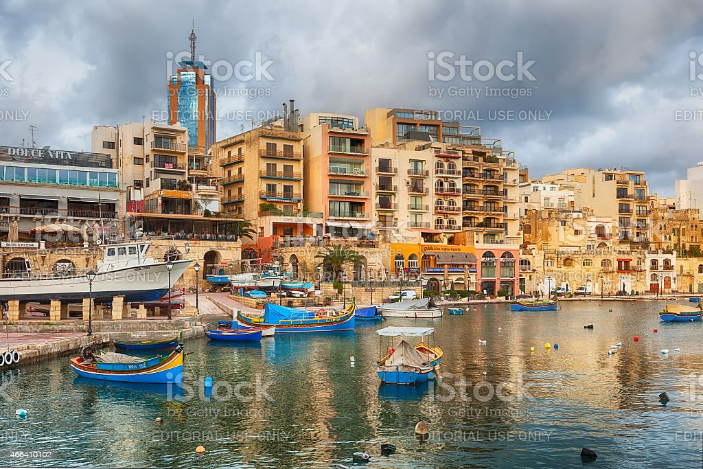 Spinola Bay with bioats in front of famous touristic restaurants stock photo