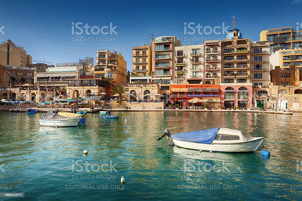 Spinola Bay with boats in front of famous touristic restaurants stock photo