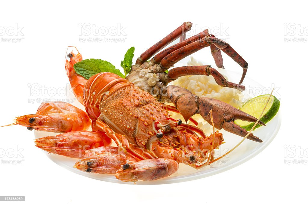 Spiny lobster, shrimps, crab legs  and rice royalty-free stock photo