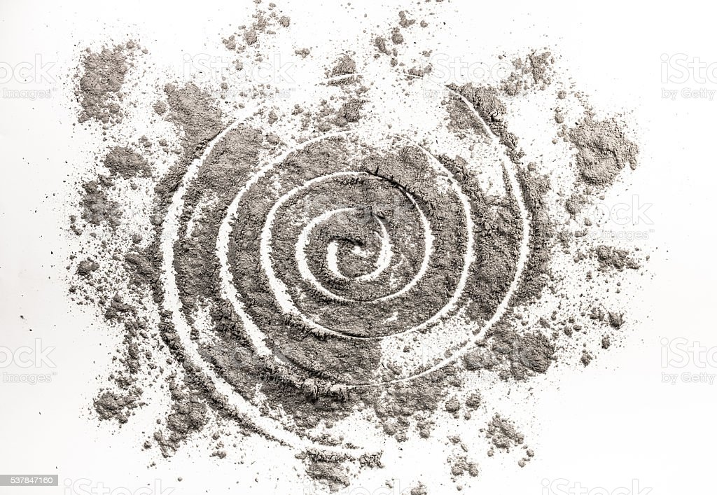 Spiral drawing in scattered ash as wormhole order in chaos stock photo