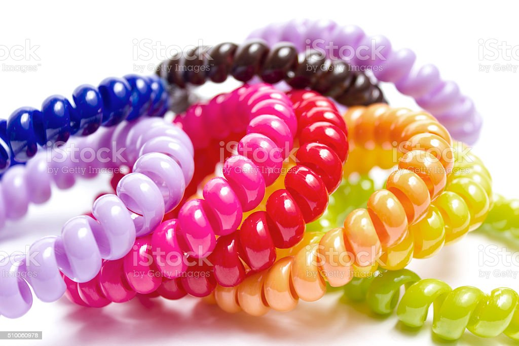 Spiral elastic rubber bands for hair of different colors stock photo