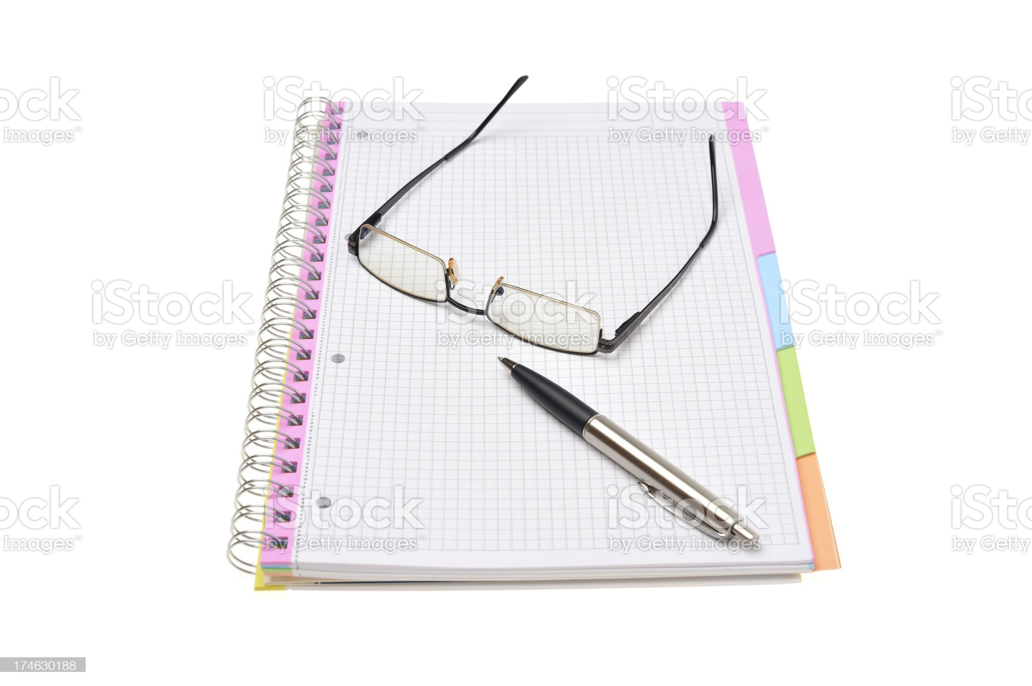 Spiral notebook, glasses and pen royalty-free stock photo