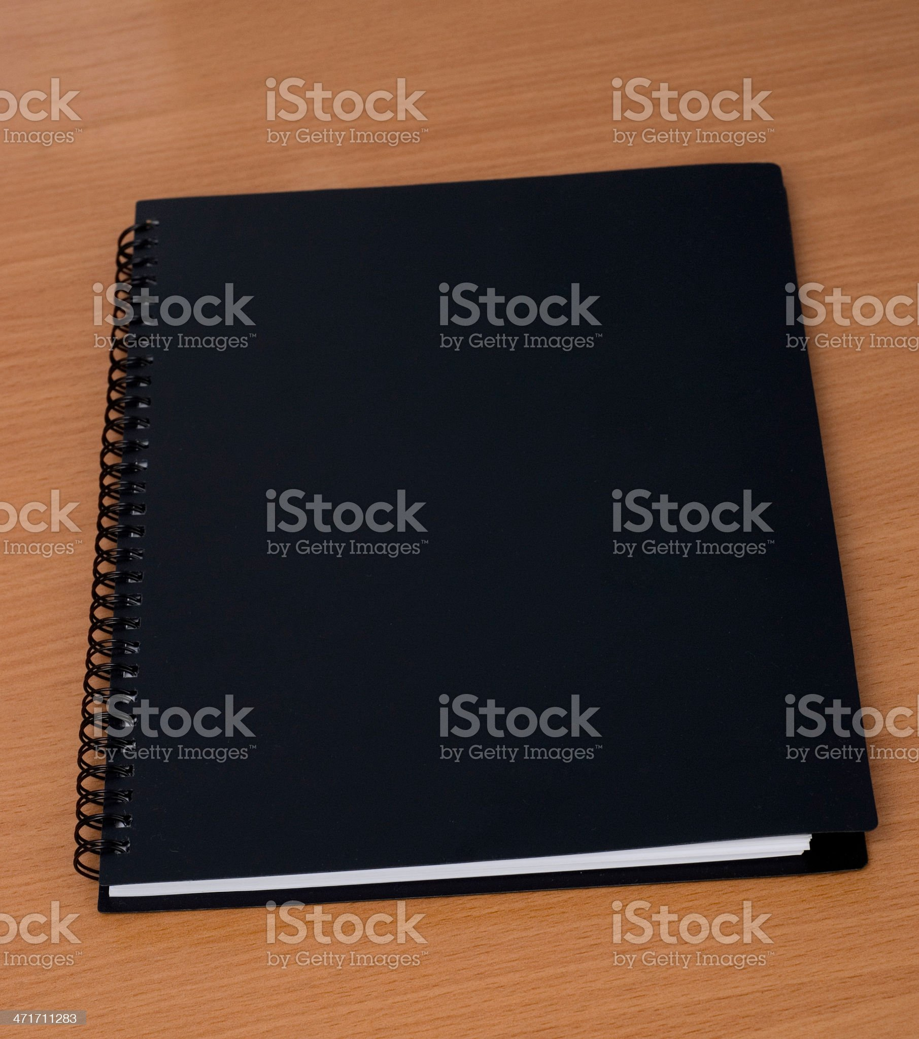 spiral notebook on a table royalty-free stock photo