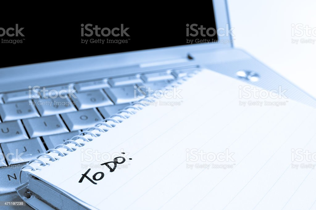 Spiral notebook on Laptop with blank ToDo List stock photo