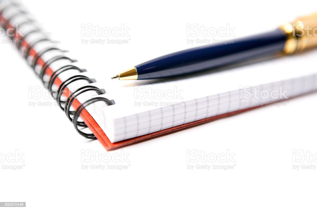 Spiral notebook with a pen on white stock photo