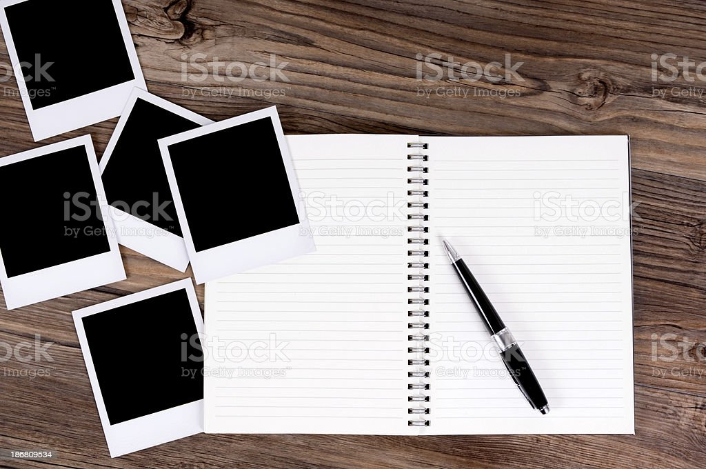 Spiral notebook with photo prints royalty-free stock photo