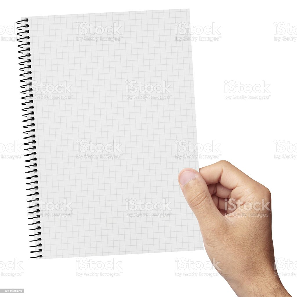 Spiral notepad in hand royalty-free stock photo
