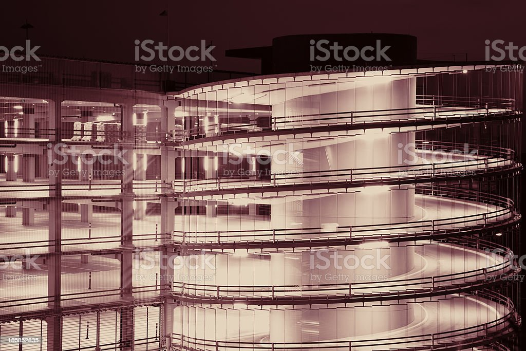 Spiral Ramp And Multi Storey Car Park Illuminated At Night royalty-free stock photo