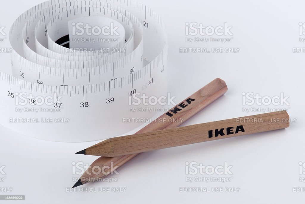 Small size wooden lead pencils and spiral paper tape measures with...