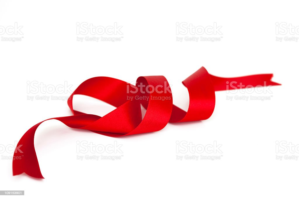 A spiral satin red ribbon with ends cut stock photo