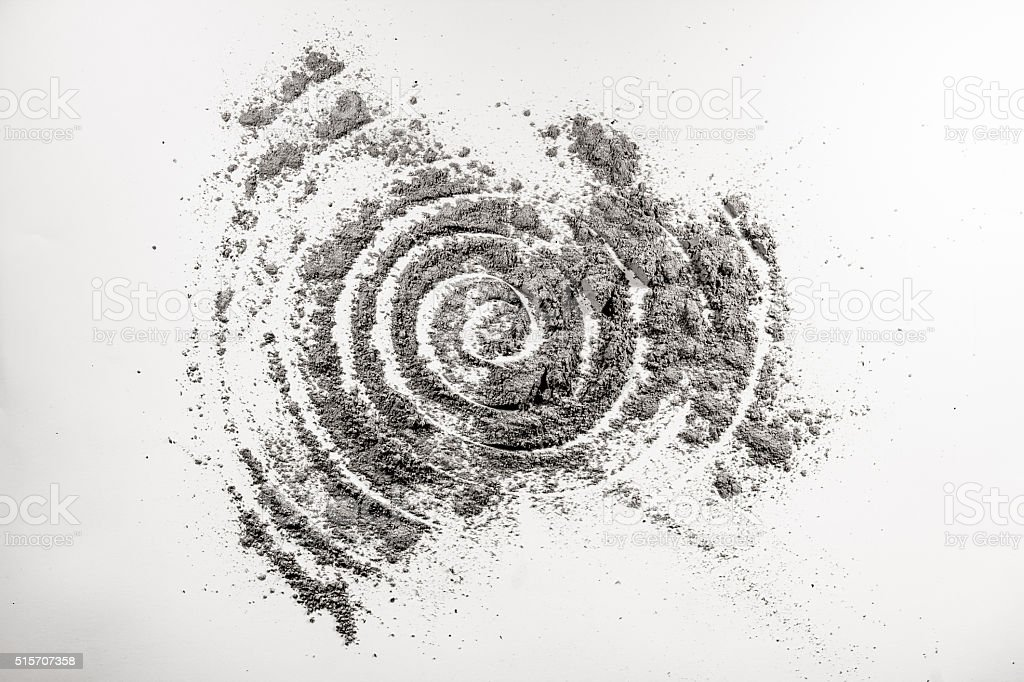 Spiral shape helix drawing in spattered ash stock photo