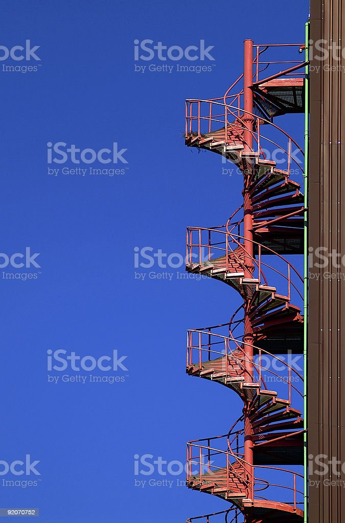 Spiral staircase and blue sky stock photo
