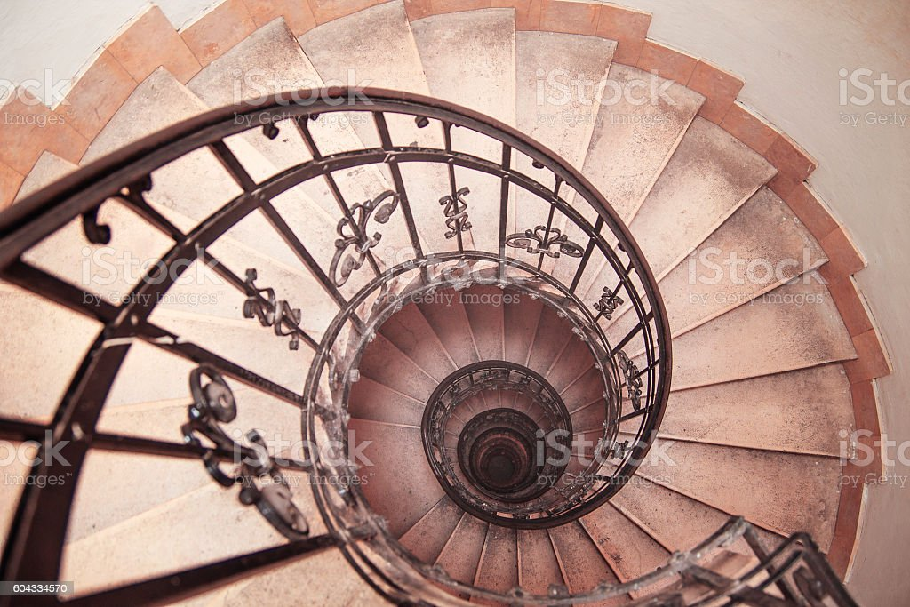 spiral staircase in an old house stock photo