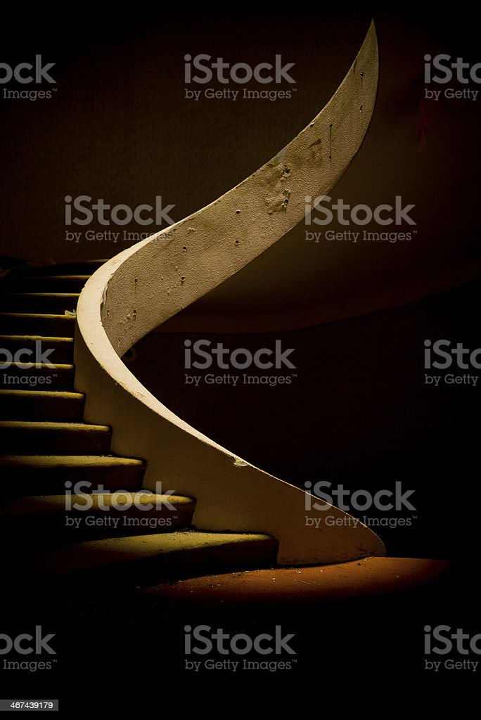 Spiral staircase in dramatic light stock photo